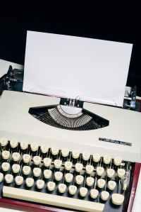 Photograph of typewriter with a blank sheet of paper inserted